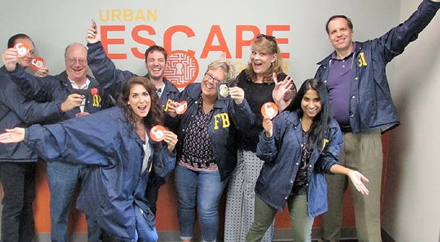 Coworkers at team building in escape room