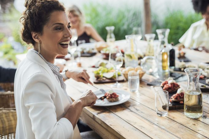 Woman Enjoying Lunch At Restaurant