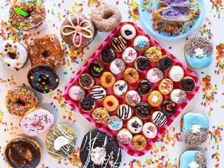 Table full of glazed Donuts