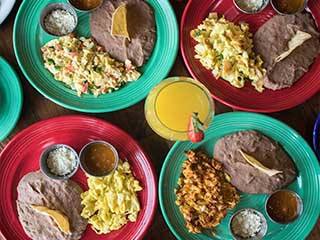 Four Plates with Refried beans and Scrambled Eggs