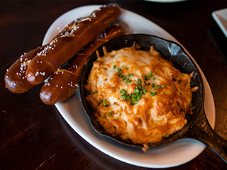 The BBQ Shepard's Pie is made with our tender pulled pork and BBQ sauce, then topped off in the oven with a blend of our mashed potatoes and cheesy Gouda