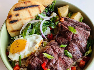 Steak With Fried Egg and Vegetables