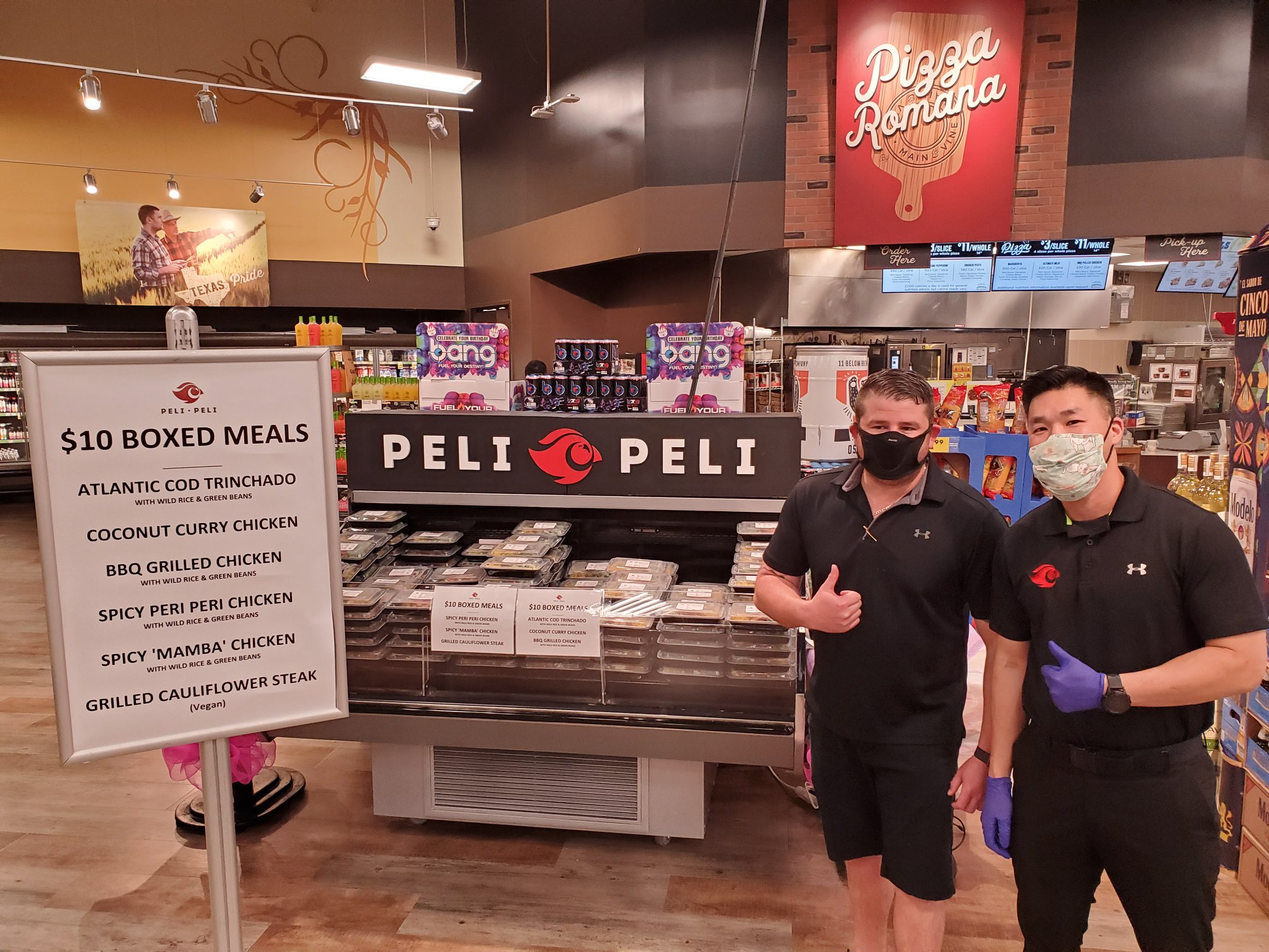 Peli Peli's Thomas Nguyen checks the restaurant's pop-up display at Kroger