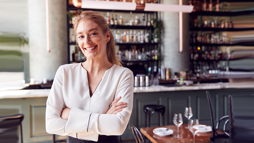 Restaurant owner ready for dinner crowd