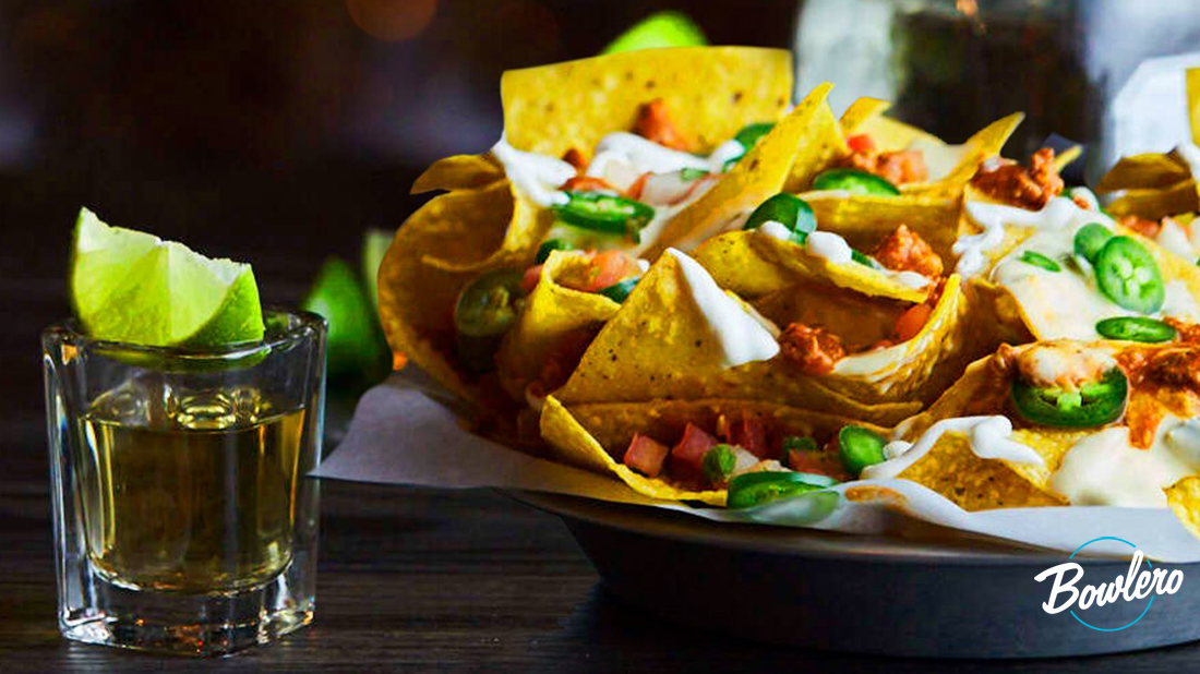 Bowlero nachos and a shot of tequila