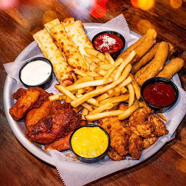 Bowlero app sampler with tenders, fries and dipping sauces